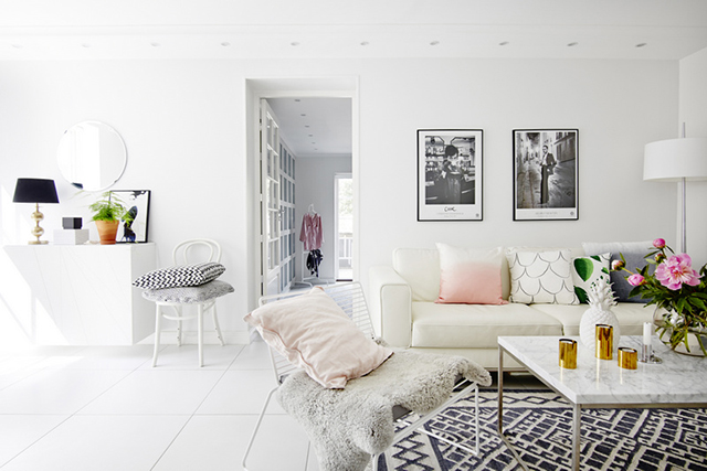 Pretty Little Details Inspiration Files // All white Scandinavian living room with touches of pink.