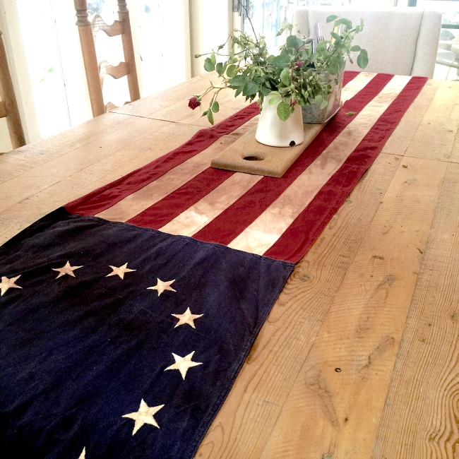 American Flag on table with flowers.