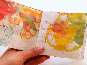 Make bubble prints with straws and turn it into a handmade notebook