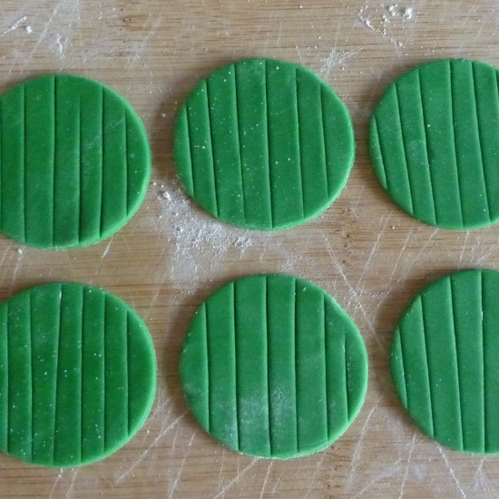 green rolled fondant icing round circles ready to use for cookies