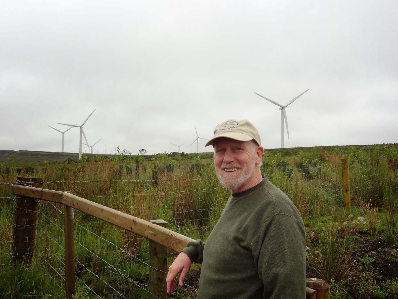 Skip stands in front of a field of wind turbines