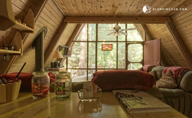 04-Living-Room-and-Entrance-Glamping-Hub-A-Frame-House-Architecture-www-designstack-co
