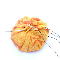 DIY spiced fabric pumpkins fall centerpieces - stitch the top of the pouch closed