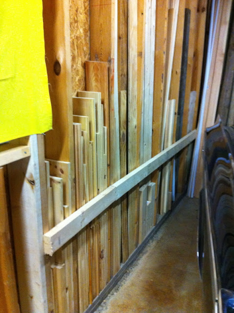 lots of pieces of wood place in between studs in the garage.