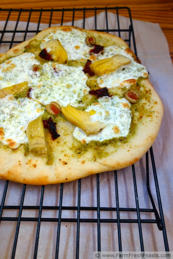 Mild garlic flavor from the garlic scape pesto, plus plenty of shredded cheeses, makes a Cheesy Garlic Scape Flatbread--a seasonal treat that can be enjoyed year round thanks to your freezer.