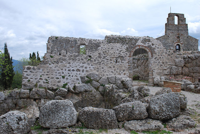 Remains of Necromanteion, with the church of the monastery Agios Ioannis in the background on the right.  Photo Jean Housen