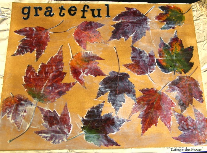 Using Mod Podge to preserve fall leaves for crafting with a toddler