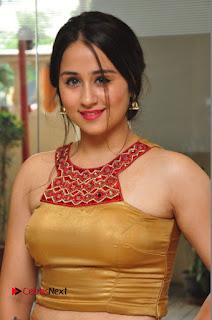 Actress Simrat Juneja Pictures in Golden Long Dress  0015