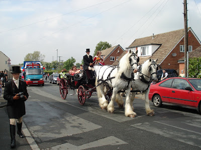 Shire horses pulling a cart in the Gawthorpe Mayday Parade
