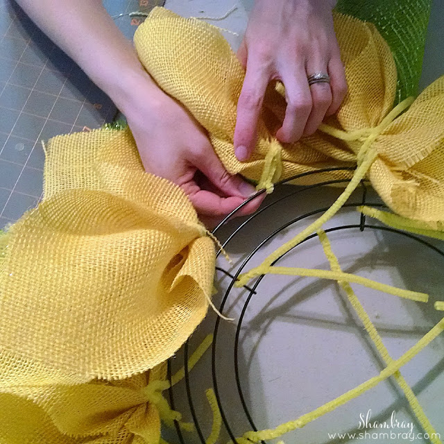 Wire wreath form, yellow burlap, green deco mesh