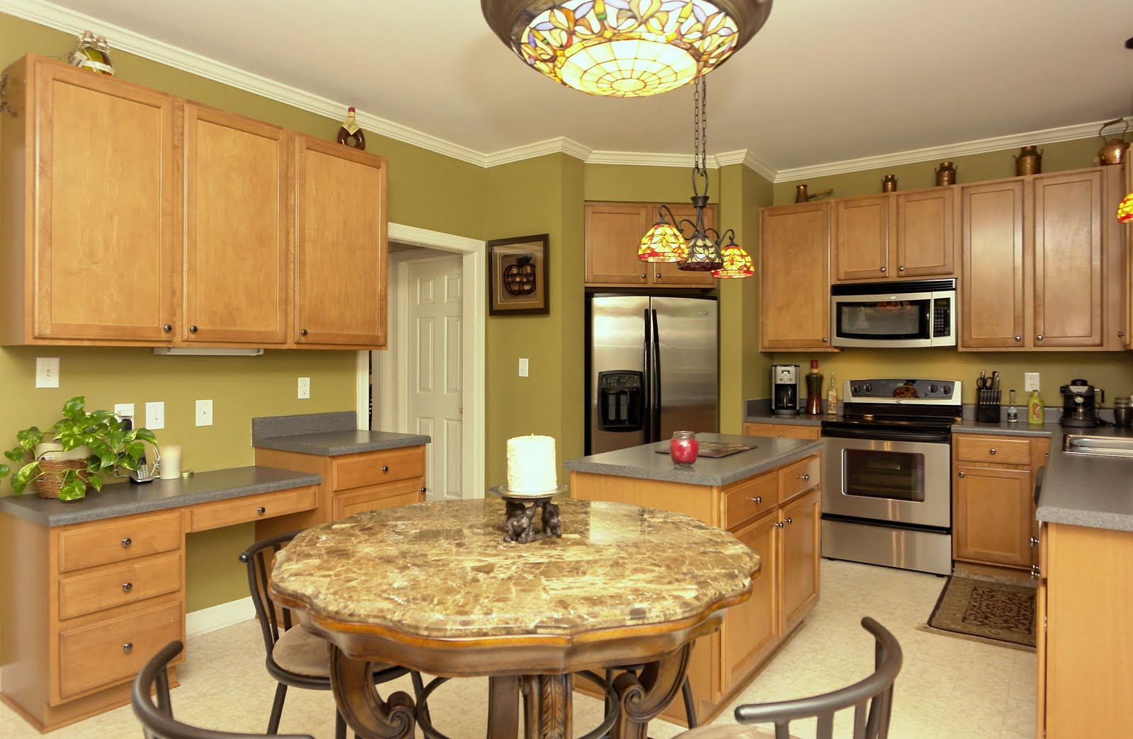 nice transitional home with fenced yard kitchen lights over table Homes by Thomas Wohl Broker RE MAX Preferred Associates