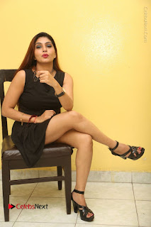 Tollywood Upcoming Actress Pooja Roshan Stills in Black Short Dress at Plus 1 Movie Trailer Launch  0322.JPG