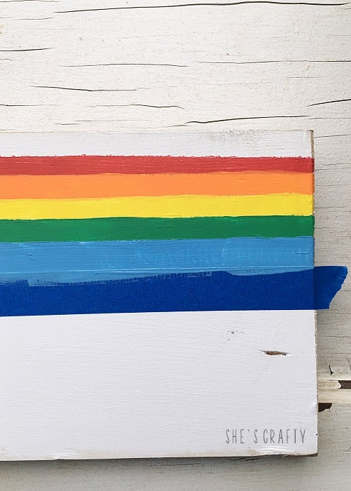 Paint stripes on wooden table runner with acrylic paint