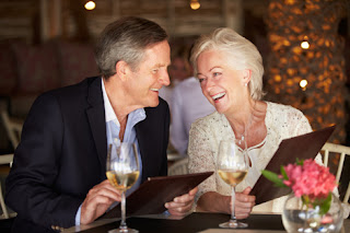 Photo of an Older Couple Dining Out