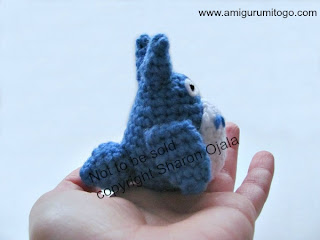 blue crochet totoro in hand