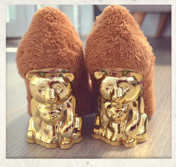 back view of gold bear heeled shoes with brown furry uppers