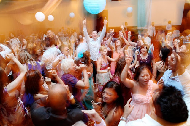 a wedding party filled in booze and dance