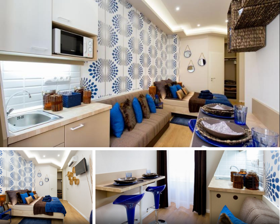 a small apartment with a double bed, sofa bed and small kitchenette