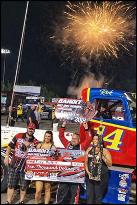 Ricky 'Rude' Proffitt celebrates his Bandit Series feature win with a $10,000 check at Hickory Motor Speedway on August 11, 2018