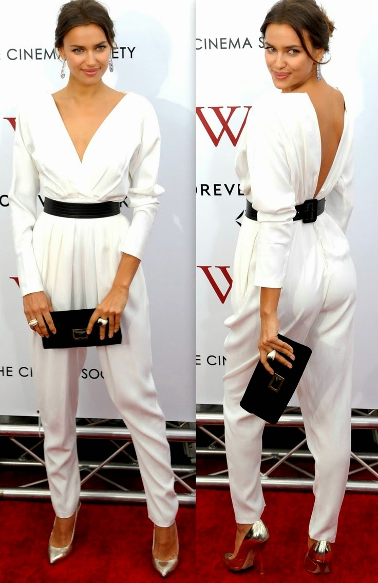 Irina Shayk in a White Jumpsuit with Metallic Silver heels