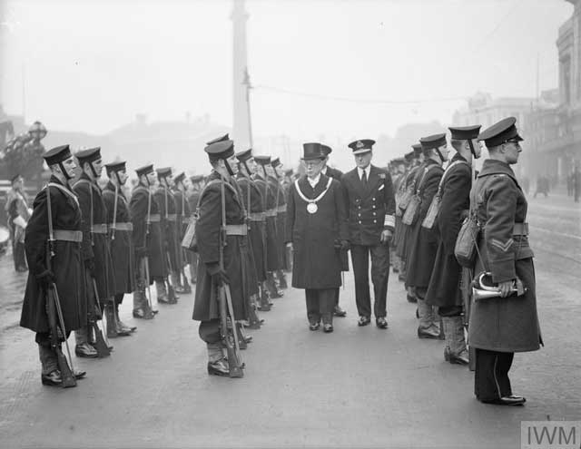 The Royal Navy commander of the Western Approaches inspecting the troops at Liverpool on 19 January 1942 worldwartwo.filminepctor.com