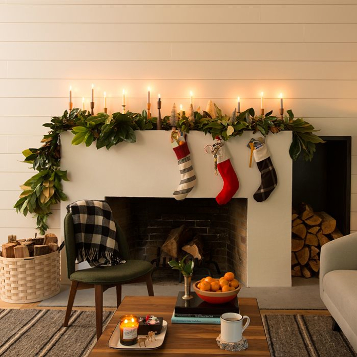 Bring the outdoors in with fresh greenery on the mantel.