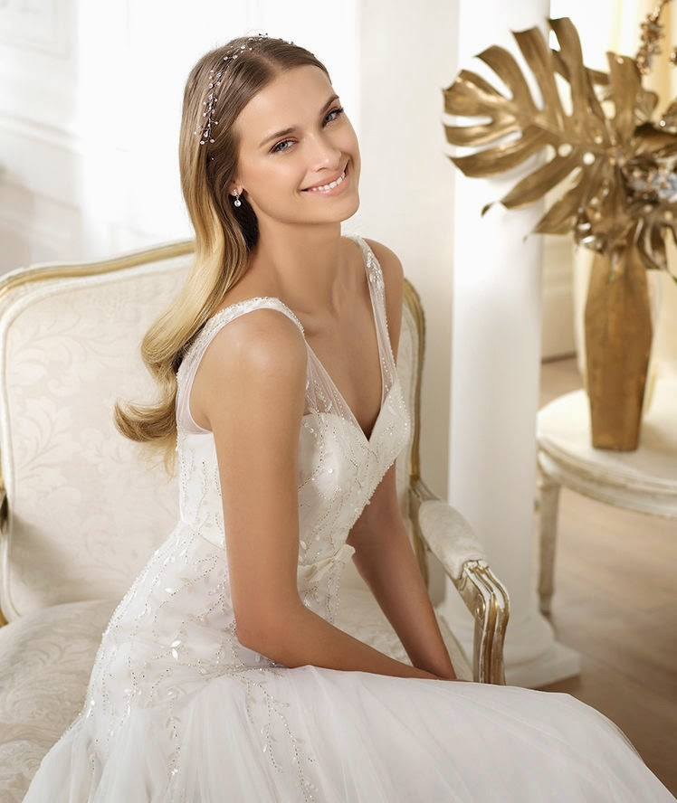 This Tulle Wedding Dress Has Silver Mother Of Pearl Embroidery It A Beautiful V Neck As Well Bow At The Front Skirt