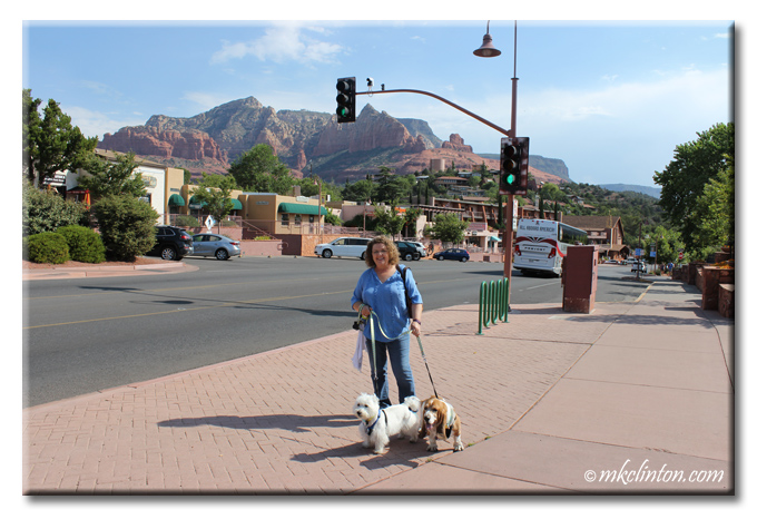 Woman, Basset and Westie on the streets of Sedona, Arizona