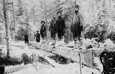 A lumber camp in Aylen Lake, Ontario. Loggers often set up camp in the winter and worked to prepare logs to be transported to the Ottawa River via waterways.