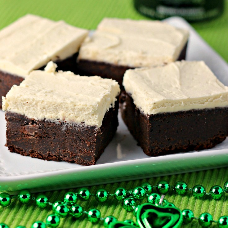 Guinness Brownies with Maple Buttercream Frosting on a white plate