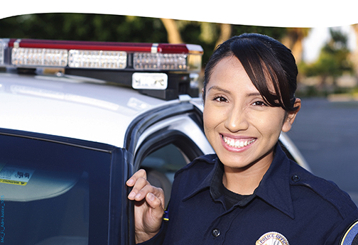 Image of a young, female police officer smiling at the camera.  Text: Administration of Justice.  Learn more.