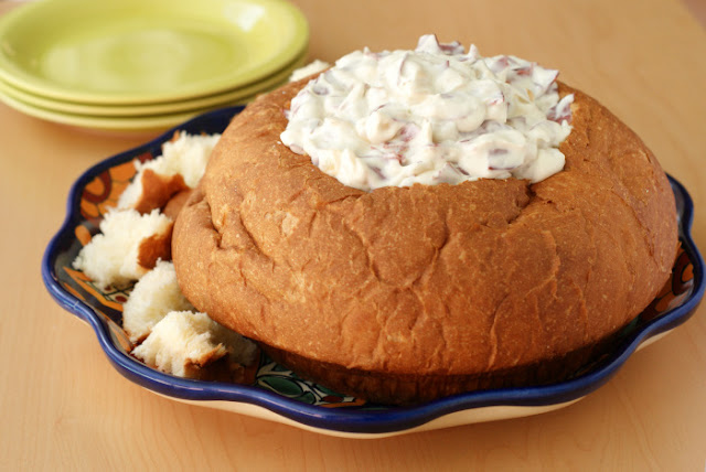Chipped Beef and Onion Dip, served in a bread bowl, is a creamy hot dip that is full of thinly sliced beef and golden caramelized onions.  It's the perfect dip for a party!