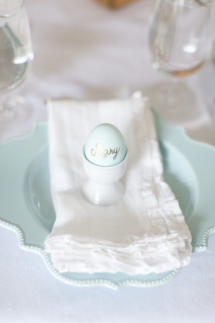 Spring table setting with ruffled linen napkins and egg place card photographed by Alea Lovely