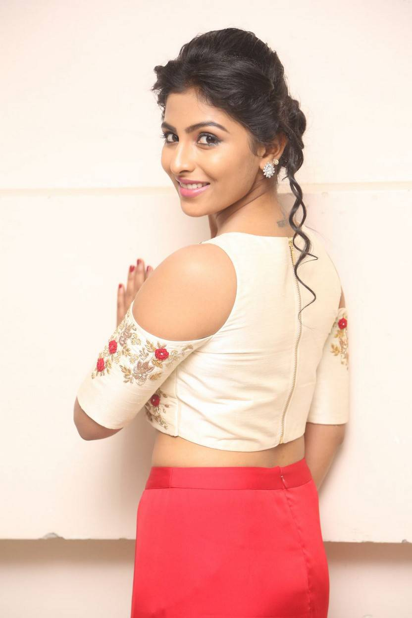 Tollywood Actress Kruthika Stills In Red Dress At Movie Trailer Launch