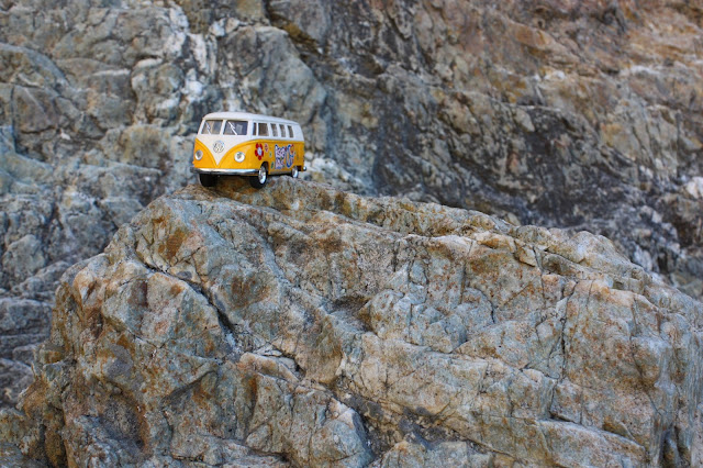 the yellow van on a rock cliff