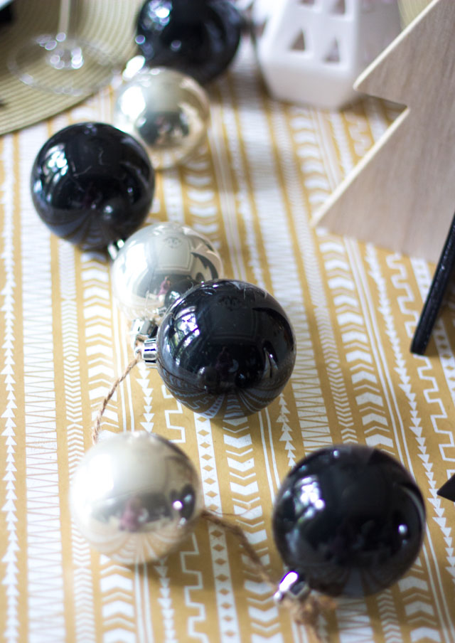 Love this idea for a simple Christmas ornament garland used as a table runner!