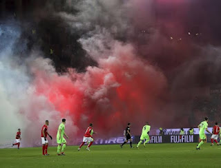 Hartmann was forced to suspend the game for several minutes early in the last half as flares in the away block stuffed the stadium with smoke