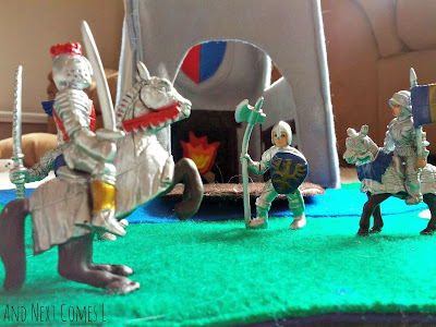 Close up of knights and dragons figures on the felt castle play tote from And Next Comes L
