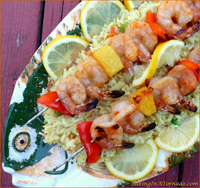 Thai Shrimp Skewers: shrimp marinated and skewered with red pepper and pineapple, a flavorful dinner that grills up in minutes. | Recipe developed by www.BakingInATornado.com | #recipe #dinner #shrimp