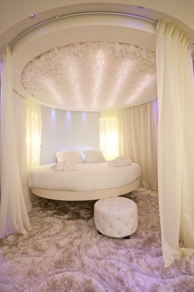 30 round beds that will spice up your bedroom for Hotel drapes for sale