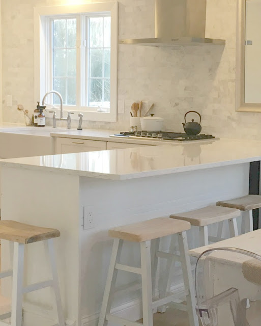 Serene white simple modern farmhouse kitchen with Minuet quartz and marble subway tile