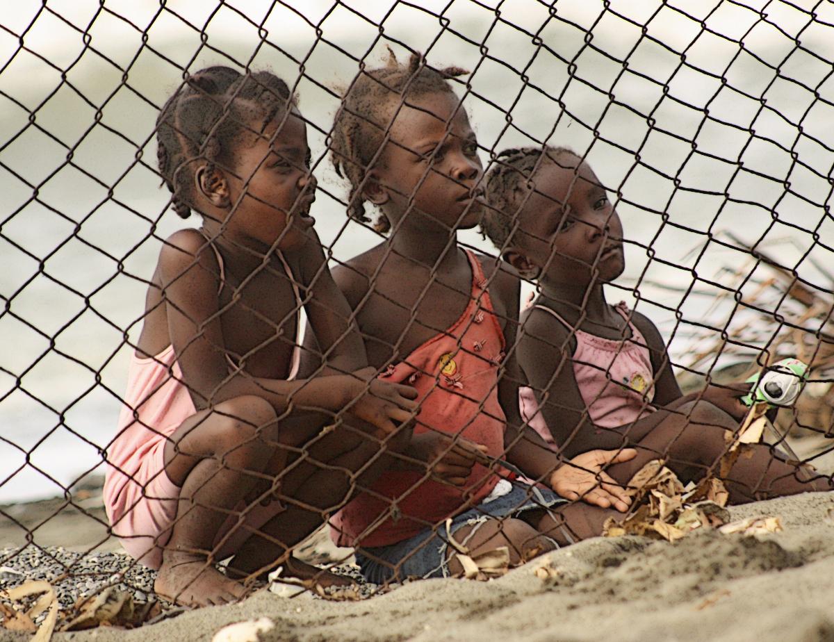 Haitian girls behind fence
