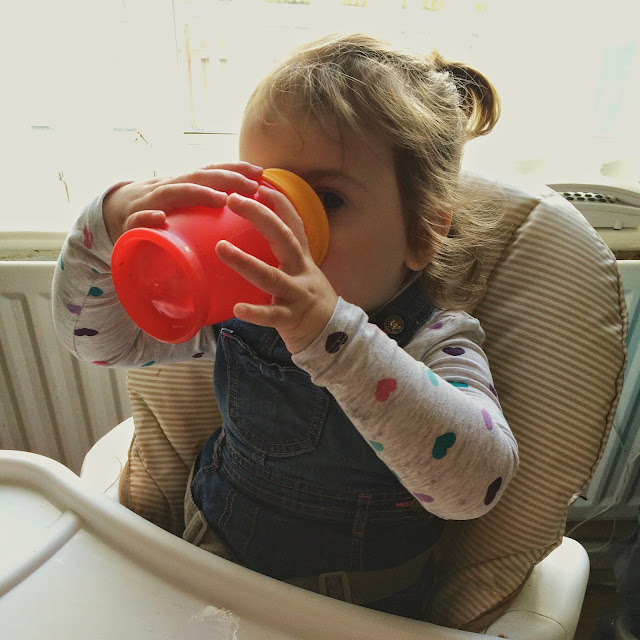 Sophia drinking out of beaker