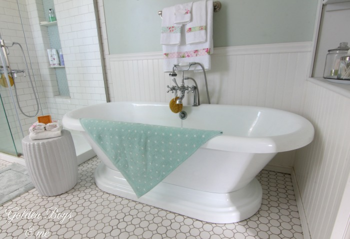 Pedestal tub in DIY bathroom with vintage style tile floor - www.goldenboysandme.com