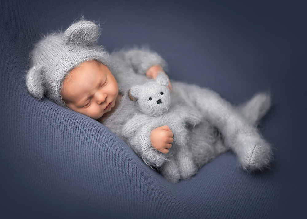 newborn baby boy in bear outfit looks like a painting DeKalb sycamore IL photographer