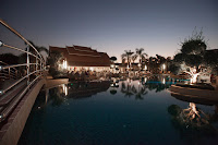 Swimming pool at night at Thai Garden Resort in Pattaya, Thailand