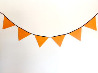 bunting draped on plain wall