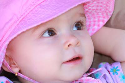 socute-baby-closepose-pink-dress-cap-walls