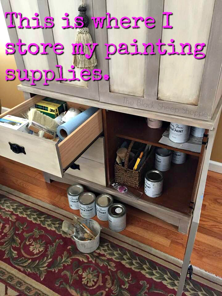 Paint supplies stored in TV armoire.