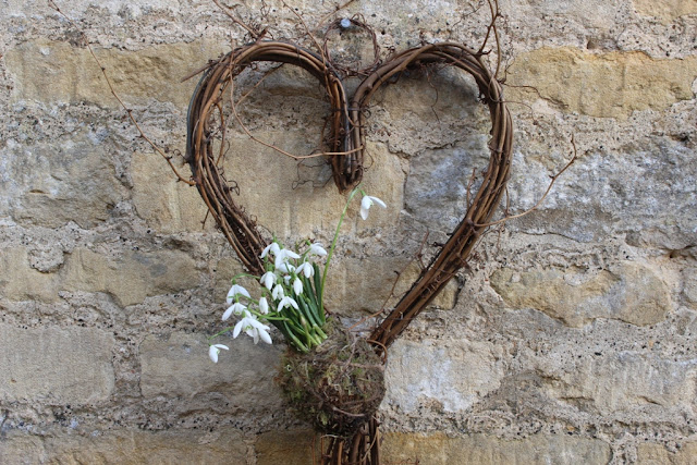 A simple woven heart with snowdrop kokedama makes a cute Valentine